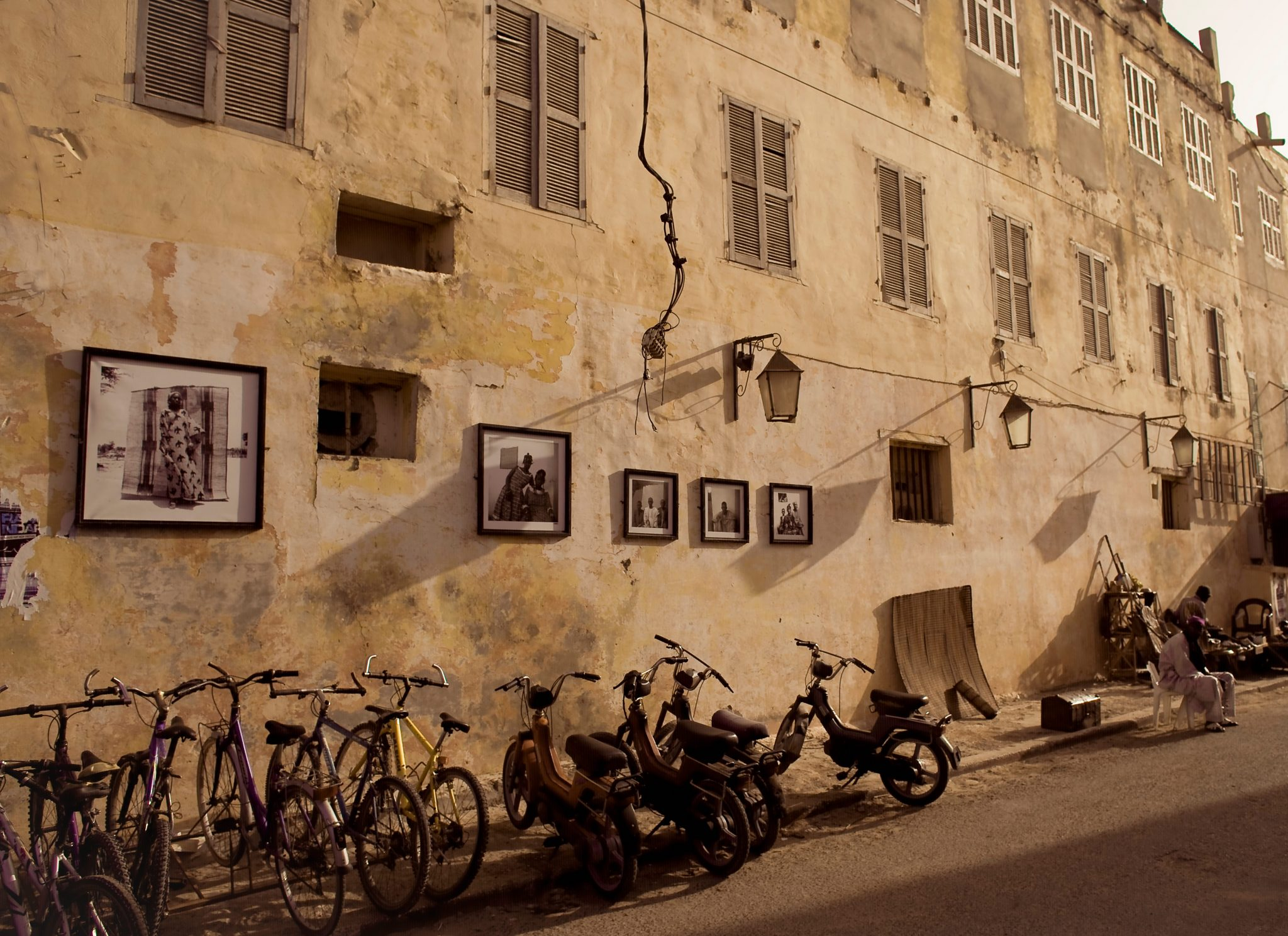 Bicycles and Photographs Near the Office of Ismael