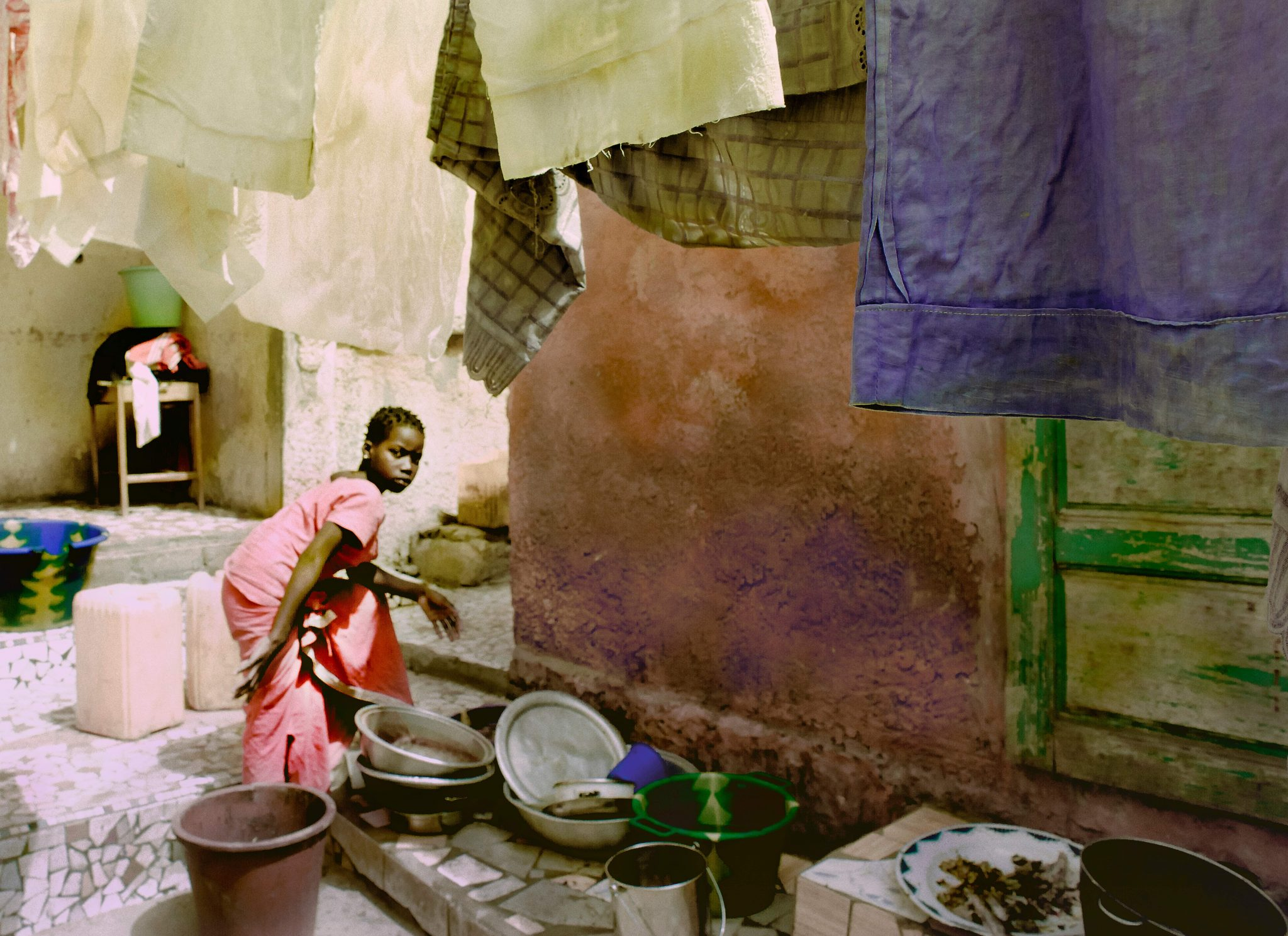 Road to Podor, Girl Washing Clothes