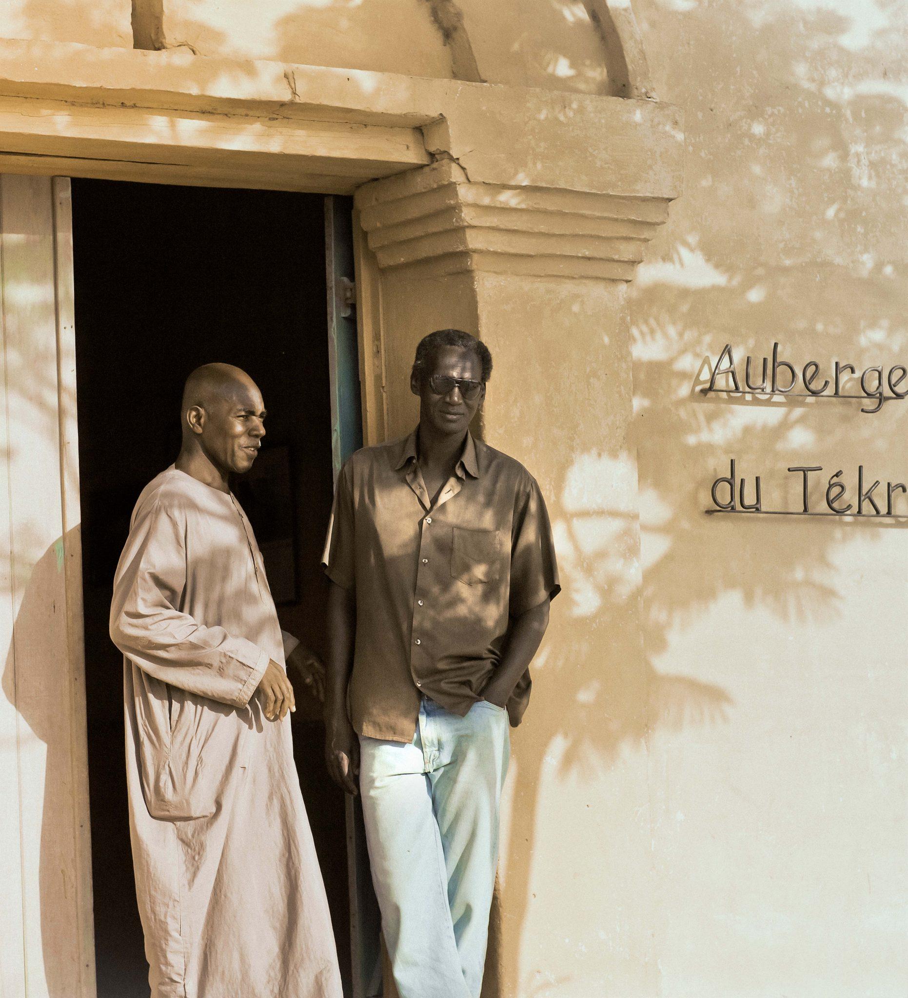 Two Men Standing in Doorway in Podor